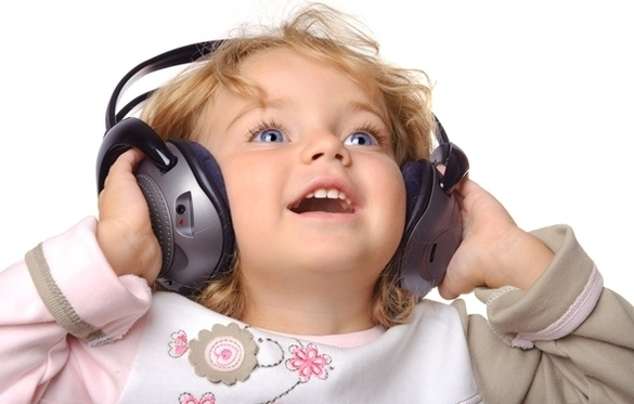 Female toddler listening to music with headphones
