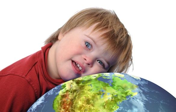 Young Special Ed student with his head resting on a globe